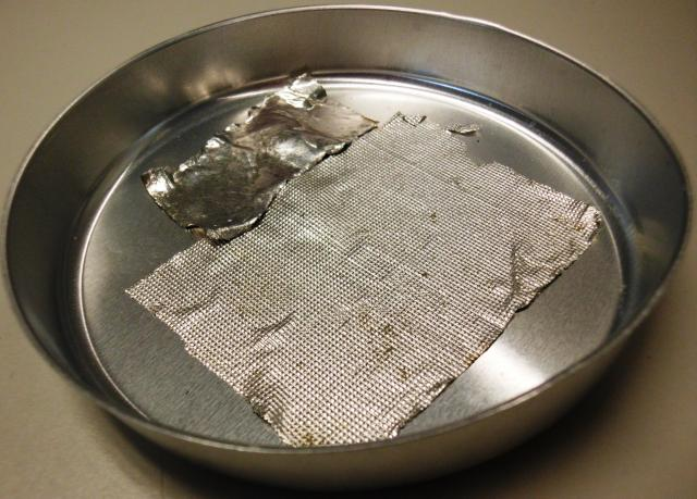Indium ribbons pressed into the bottom of an aluminum pans