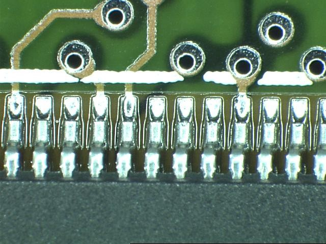 Component leads soldered to a printed circuit board.
