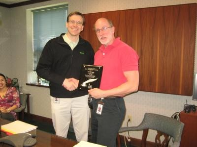 Ed Briggs receiving the 2008 Silver Quill Award from Ross Berntson, VP of Marketing & Sales.